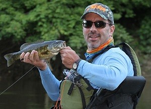 Ed Roden of the Hobie Fishing Team with a Flint River smallmouth bass. Ed is wearing Maui Jim Banyans in bronze toned lens.