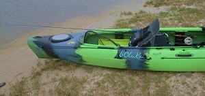 Rear of kayak shown:  Fly rod positioned rearward, using front bungy position within hull just forward of seat.